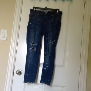 ripped blue skinny jeans with distressed hem